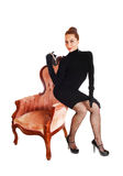 Woman sitting on armchair. Royalty Free Stock Images