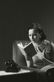 Worried woman reading a book Royalty Free Stock Image