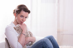 Woman sitting in armchair with teddy Royalty Free Stock Photography
