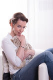 Woman sitting in armchair with teddy Royalty Free Stock Photo