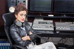 Woman Sitting With Arms Crossed At Mixing Desk Stock Photos