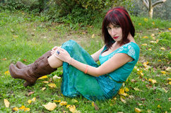 Woman sitting on the autumn leaves Royalty Free Stock Image