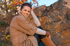 Woman sitting in autumn outdoors in evening Royalty Free Stock Photography