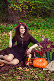 Woman sitting in autumn park with vegetables Royalty Free Stock Photos