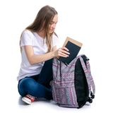 Woman sitting with backpack put notebook book. On white background isolation stock images
