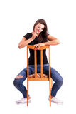 Woman sitting backwards on the chair smoking cigarette Royalty Free Stock Images