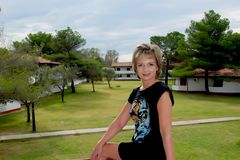 Woman sitting on the balcony. Against the sea bungalows, nudist resort Ada Bojana. Montenegro Stock Image