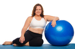 Woman sitting with a ball Stock Photography