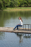 Woman sitting on a bamboo raft in river Royalty Free Stock Images