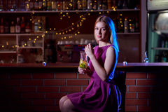 Woman sitting at the bar Stock Photography