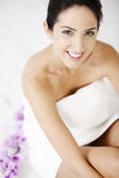 Woman sitting in bath towel Royalty Free Stock Image
