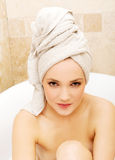 Woman sitting in bathtub. Stock Photo
