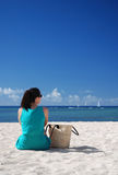 Woman sitting on beach Royalty Free Stock Photo