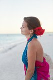 Woman sitting on the beach. Young woman sitting on the beach and dreaming Royalty Free Stock Photos