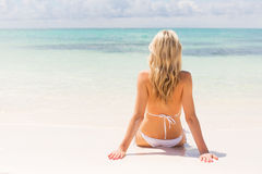 Woman sitting on the beach Stock Photography