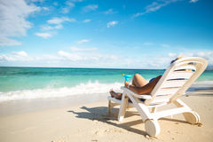Woman  sitting on a beach chair Stock Image