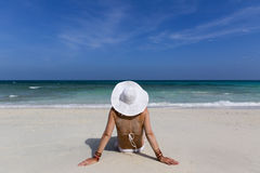 Woman sitting on a beach Royalty Free Stock Image