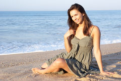 Woman sitting on beach relaxing Royalty Free Stock Photo