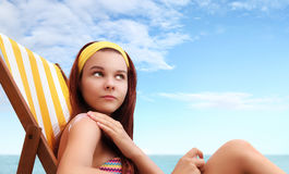 Woman sitting at the beach you put the sunscreen Stock Photos