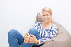 Woman sitting on a beanbag Royalty Free Stock Photo