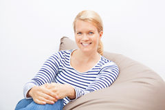 Woman sitting on a beanbag Stock Photography