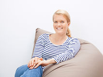 Woman sitting on a beanbag Royalty Free Stock Images