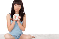 Woman sitting on bed Stock Image