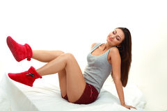 Woman sitting on the bed Stock Photo