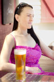 Woman sitting  in a beer garden portrait Royalty Free Stock Photo