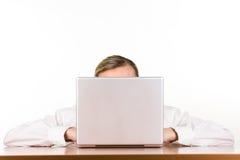 Woman sitting behind computer Royalty Free Stock Photo