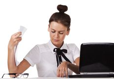 Woman sitting behind a desk through the documents Royalty Free Stock Images
