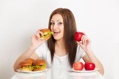 Woman sitting behind the table with food Royalty Free Stock Photos