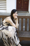 Woman sitting on bench Royalty Free Stock Photos