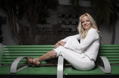 Woman sitting on a bench Stock Image