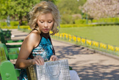 Woman sitting on a bench Royalty Free Stock Images