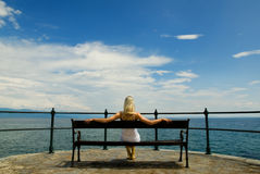 Woman sitting on a bench Stock Photo