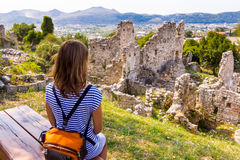 Woman sitting bench above ruins. Royalty Free Stock Photos