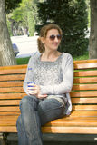 Woman sitting on the bench Royalty Free Stock Image