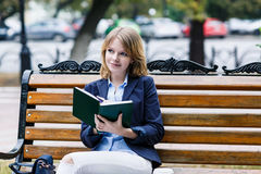Woman sitting on the bench with diary Royalty Free Stock Photo