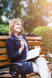 Woman sitting on the bench with diary Royalty Free Stock Photography