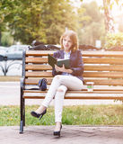 Woman sitting on the bench with diary Stock Photos