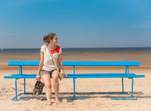 Woman sitting on bench Royalty Free Stock Photography