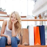 Woman sitting on bench at mall Royalty Free Stock Photos