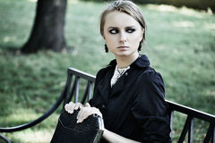 Woman sitting on a bench in park Royalty Free Stock Photography