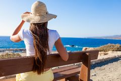 Woman is sitting on the bench at the sea Royalty Free Stock Image