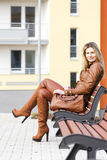 Woman sitting on bench Stock Photo