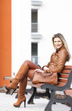 Woman sitting on bench Royalty Free Stock Image