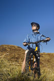 Woman Sitting On Bicycle In Field Royalty Free Stock Images