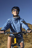 Woman Sitting On Bicycle In Field Royalty Free Stock Image