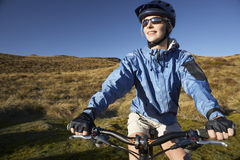 Woman Sitting On Bicycle In Field Stock Photos